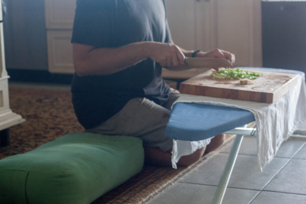 Multitasking – stretching my quads and making dinner.
