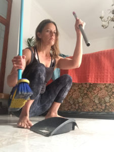 Katy M: I RESIST fascist household technology that won't allow my hips their full range of motion! I BREAK (or gently remove because this is a rental house and it's not mine) the dustpan handle and SQUAT to sweep! Also: for more movement you can make lots of little piles of dirt all over the floor and then squat-walk to each one to sweep it up. Try it! It's fun!
