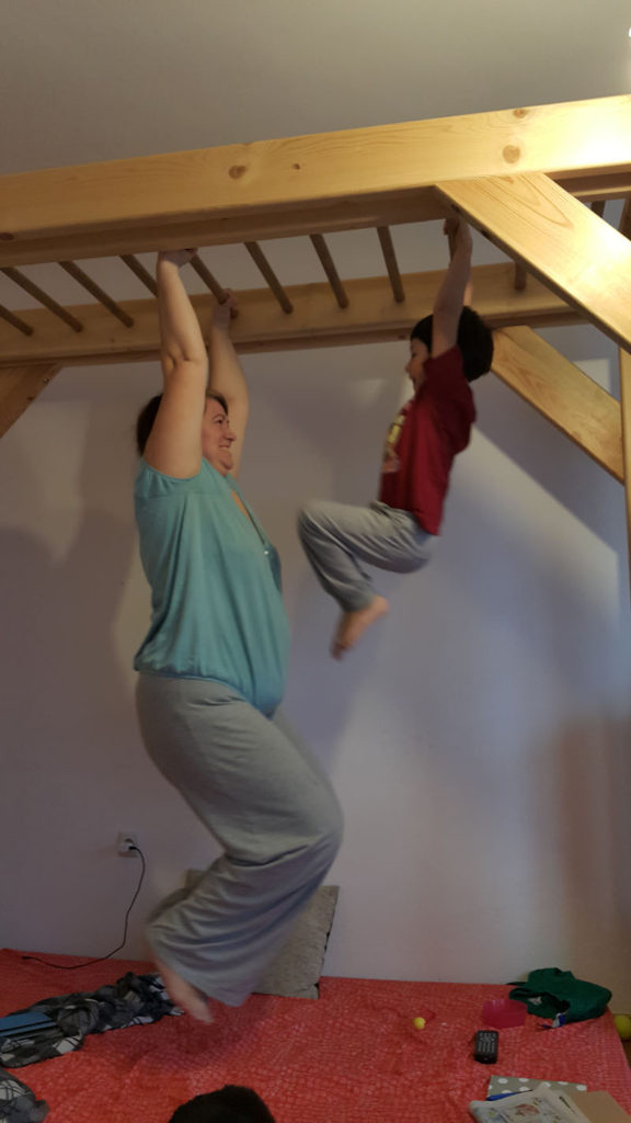 Martina N.: Here's our favourite monkey bar - custom-made so it would fit the room and so we could all use it. It's highly configurable here you see the maximum height - high enough even for a 6.2 guy to do some hanging.