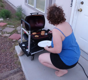 Tracey T: Every meal that involves grilling or baking starts with me lifting up the HEAVY cast iron Weber electric grill and carrying it through the kitchen and living room to the cart by the front door. Then once outside and plugged in all the food flipping and general poking is done while squatting. (edited)