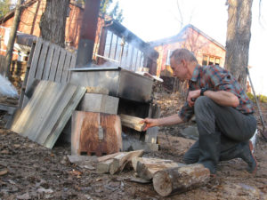 Walt S: Loading the wood stove. Lots of bending down, so I try to squat and switch knees each time I do.